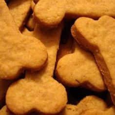 Cut-out dog biscuits with rolled oats, cornmeal and cheddar cheese. You can change the flavor of these by substituting chicken bouillon for the beef.