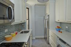 grey-blue subway tile, simple white cabinets