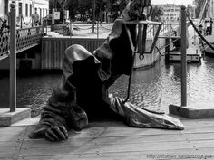 This sculpture is called Juodasis vaiduoklis (The Black Ghost) and is located in Klaipėda, Lithuania