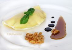 A popular dessert in South East Asia, Durian Pancake is a type of crepe filled with durian & cream. This is an Asian inspired plated dessert of Durian Pancake with Almond Praline & Gula Melaka Caramel Sauce. Yummy Appetizers, Appetizer Recipes, Crepes Filling, Indonesian Desserts, Pancakes And Waffles, Delish, Caramel, Almond, Deserts