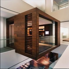beautiful office  love the concept of a cantilevered wood cube