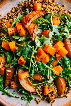 This quick and easy 55-minute butternut squash recipe incorporates crushed red pepper, pears, ginger, garlic, turmeric, quinoa, scallion, onion, rosemary, red chile and arugula to create the ultimate fall recipe. Whether you're eating this butternut squash recipe as a quick and easy weeknight dinner, side dish, appetizer, snack or light lunch, it's a great choice for a pear recipe. #fallrecipes #butternutsquash #butternutsquashrecipes #pearrecipes #squashrecipes #saladrecipes