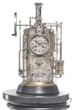 French - retailed by J.E. Caldwell, Philadelphia: a brass automaton vertical steam boiler industrial clock, c.1890