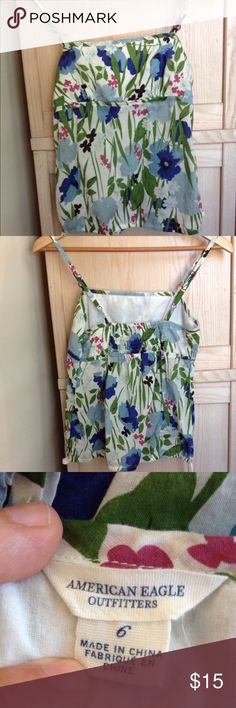 American Eagle Outfitters floral tank Floral tank with adjustable straps, back shirring, and a drawstring waist. Cotton lining in the bust area. Adorable fuschia hardware throughout. American Eagle Outfitters Tops Tank Tops