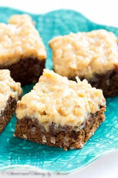 german chocolate brownies  /3 cup (75gr) unsalted butter •4oz (120gr) semi-sweet chocolate, broken into pieces •½ cup (100gr) sugar •2 large eggs, at room temperature •2 teaspoon pure vanilla extract •2/3 cup (85gr) all-purpose flour •1 teaspoon instant espresso powder* •¼ teaspoon salt   Coconut-Pecan Frosting: •½ cup chopped pecans •¼ cup sweetened coconut flakes •1 large egg yolk •¼ cup brown sugar •1/8 teaspoon salt •2 tablespoon butter •½ c heavy cream •½ t vanilla