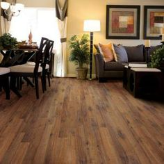 $0.89 / sq ft Home Legend Palace Oak Dark 8 mm Thick x 7-9/16 in. Wide x 50-5/8 in. Length Laminate Flooring (21.30 sq. ft. / case)-HL1004 at The Home Depot