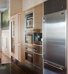 Another tall-wall station holds a pantry, coffeemaker and refrigerator in addition to the ovens and microwave. This wall is quite the workhorse.