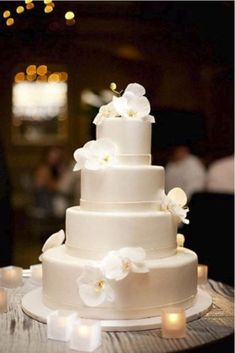 Floral Wedding Cakes 25 Timeless Yet Trendy All-White Wedding Cakes Orchid Wedding Cake, Wedding Cake Fresh Flowers, Floral Wedding Cakes, White Wedding Cakes, Elegant Wedding Cakes, Cool Wedding Cakes, Wedding Cake Designs, Wedding Cake Simple, Rustic Wedding
