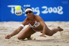 BEIJING - AUGUST 12:  Misty May-Treanor of the USA dives for the ball against Tamara Larrea and Dalixia Fernandez of Cuba in the Women's Preliminary Pool B match held at the Chaoyang Park Beach Volleyball Ground on Day 4 of the Beijing 2008 Olympic Games on August 12, 2008 in Beijing, China.  (Photo by Jeff Gross/Getty Images)