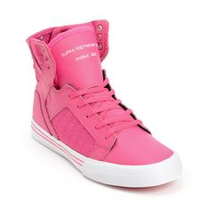 Elevate your skate look with a girly twist in the Supra Kids Skytop Skytop Pink skate shoe for girls. These youth sized high top skate shoes feature a durable Pink leather upper with Pink glitter canvas side panels, elastic tongue straps and padded ankle support for protection and a Pink vulcanized sole with White foxing for incredible board feel. A heel loop tab allows the Supra Skytop to be pulled on easily and three reinforced purple metal lace eyelets at the top padded collar keep your…