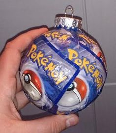 The backs of pokemon cards used to decorate this ball ornament makes the perfect gift for the pokemaster in your life, or a great way to geekify