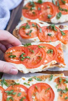 A hand reaching in to take on slice of Tomato Basil Mozzarella Toasts | tastesbetterfromscratch.com Clean Eating Snacks, Healthy Snacks, Healthy Recipes, Spinach Recipes, Top Recipes, Healthy Eating, Yummy Appetizers, Appetizer Recipes, Simple Appetizers