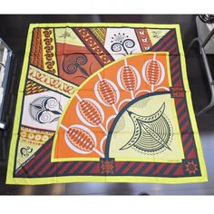This is an authentic HERMES Cashmere Silk Geometrie Cretoise Shawl 140.   This stylish large shawl is 65 cashmere and 35 silk and features a geometric African pattern.