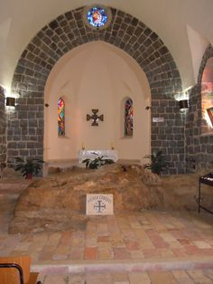 """The Church of the Primacy of St. Peter contains a projection of limestone rock in front of the present altar which is venerated as a """"Mensa Christi"""", Latin for table of Christ. According to tradition this is the spot where Jesus is said to have laid out a breakfast of bread and fish for the Apostles, and told Peter to """"Feed my sheep"""" after the miraculous catch, the third time he appeared to them after his resurrection. (John 21:1-24) - Photo: Bruce Bryant"""