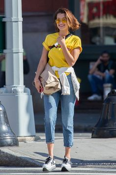 Bella wore a yellow T-shirt and sunglasses with cropped jeans and platform Hogan trainers.