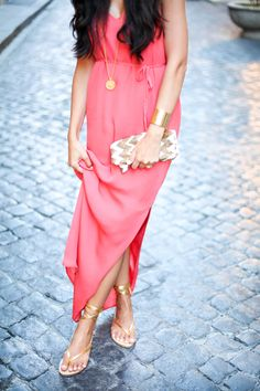 Gold lace up sandals and coral maxi dress.