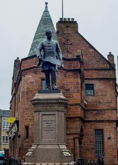 Sir William Pearce at Govan Cross with Brechin's Bar behind.