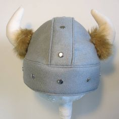 Felt children Viking Helmet.  This helmet is perfect for a fancy dress party or simply for imaginative play. It also make a perfect warm winter hat. It is made with felt so it is very soft yet hardwearing. The horns are made with a heavy cotton canvas and trimmed with faux fur. Available in the following sizes:  2-3 years: 50-52cm 4-5 years: 53-55cm 6-7 years: 56-58cm 8 years- adult: 59-61cm