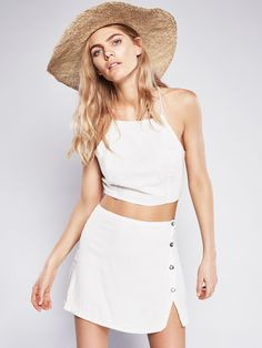 I Found You Skirt Set | In a lightweight cotton-blend this set features a crop top with adjustable straps in back and a mini skirt with exposed button closures. Easy and effortless this style is the perfect throw-on for a night out after a day at the beach.