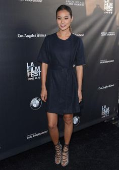 Jamie Chung in a navy short-sleeve dress and Raye heels