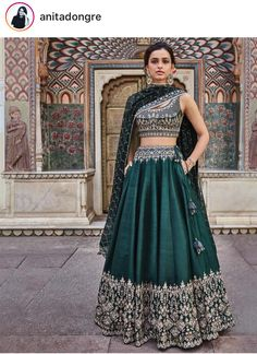 Beautifully embroidered with our signature craft Gota Patti, the Vatsala Lehenga sparkles with every step you take. The emerald green silk lehenga is perfect for any royal occasion. Style Tip: Pair this beautiful lehenga with jadau chand b Indian Lehenga, Green Lehenga, Indian Gowns, Indian Attire, Indian Wear, Raw Silk Lehenga, Indian Dresses For Women, Indian Wedding Outfits, Indian Outfits