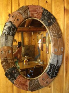 Mirror  made from cowboy boots. I want to make this with my son's old boots