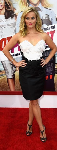 Reese Witherspoon struck a pose at the premiere of her new movie, Hot Pursuit, in a sexy but sophisticated black-and-white dress, which she paired with some t-strap heels.