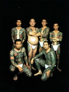 This is one of those famous photos of Yakuzas showcasing the traditional full suit tattoos.