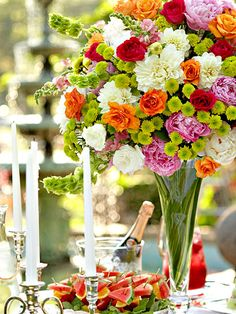 Colorful bouquet - roses, spray mum, snapdragons, dahlias, bells of Ireland, and peonies, set the tone for the flowery garden gathering.