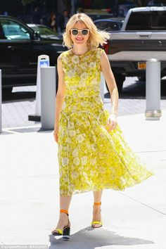 A ray of sunshine! Naomi Watts stepped out in a bright yellow sundress during a busy day i...