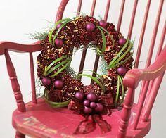 Red Rose Wreath        Use floral wire to secure 'Hocus Pocus' roses, in luscious red tinged with yellow, to a foam wreath form. Fill in holes by gluing fresh juniper to this fragrant wreath. Matte ornaments, glued to the wreath, provide a soft counterpoint to the bright green Lily Grass wound throughout.