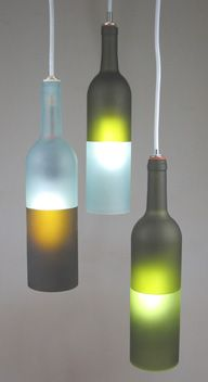 """Khrysalis Light Sculpture is an  extension of the bottle experiment.  Khrysalis comes from the description  of the visual you see when they are  lit and hanging. They have an organic  quality with a mystical illumination.  Each comes with an 11-1/2"""" long x   7/8"""" diameter 40 watt frosted tubular   incandescent showcase bulb.   Occasionally the filament of the  bulb flutters subtlely, much like the   fluttering of a butterfly about to   leave the chrysalis, thus the name.   The colors are…"""