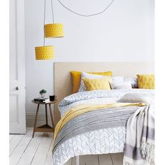 Gray and yellow bedroom.
