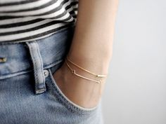 model with LITTIONARY 14k Dainty Gold Bar & Gold Tube Bracelets