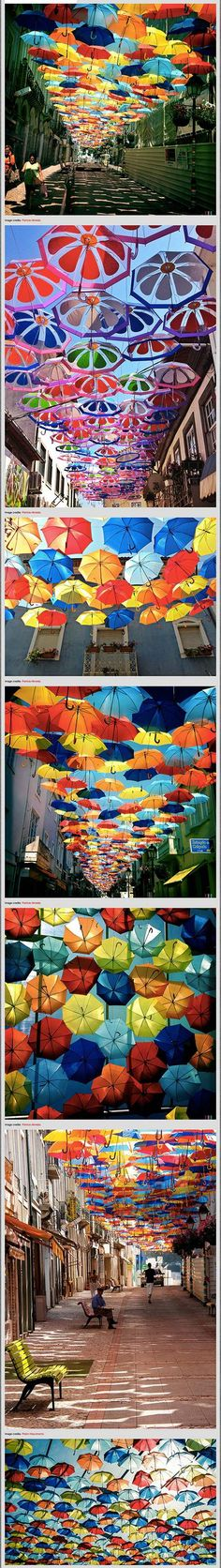 Do you remember the colorful Floating Umbrellas installation in the streets of Agueda, Portugal we posted last year? This year, Sextafeira Produções has once again hung up hundreds of colorful umbrellas, transforming your shopping experience or the afternoon walk into a Mary-Poppins type of adventure!