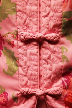 frog closures, embroidered facing, piping all from the same fabric.