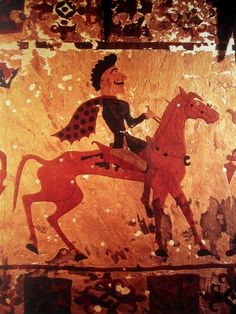 Pazyryk felt artifact, ca. 300 BC. Horseman with wonsal style moustache and partially shaved head. This ia the oldest known depiction showing a shaved man with a moustache. He is an ancient Iranian (Scythian) horseman from 300 BC