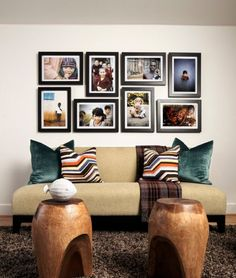 Picture frames of the same size and shape could be used to create an original and stylish décor. If you use rectangular photo frames you can alternate horizontal and vertical positions. It's an interesting way of adding a modern touch to a rather traditional method.