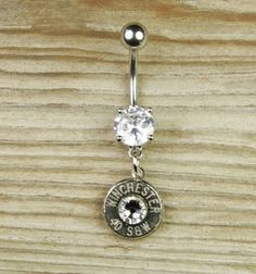 Bullet belly button ring This would totally match the earrings and necklace Kevin's parents got me