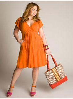 A flowy v-neck empire waist dress is a great casual look for anyone! And the bright orange hue SCREAMS summer!