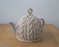 Hand knitted to one of my own cable designs this Tea Cosy is knitted in a beautifully soft, thick Pure Wool and Alpaca yarn. Helps keep your tea warm and looks great as well!! Listing is for the Teapot cover ONLY. Size: Height to top of lid 14.5cm (5 3/4), Circumference 47cm (18 1/2)