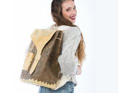 HANDMADE Backpack, Flower bag, Natural Materials, BACKPACK, Individual bag, Natural leaves, CASUAL Style, Attractive look, Artwork Backpack  This unique backpack is all made by hand becoming a masterpiece. All the materials used are collected from the hellenic nature and processed properly to last for a long time. The colours in shades of brown and light yellow were selected carefully for an easy combination with any attire. Lets celebrate the Happy Mother's Day with 20% discount on all…