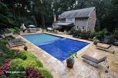 A cool pool is especially refreshing. Some worry that a pool may be dangerous with younger children running around. The auto-cover on this pool located in Baldwin, NY makes it very safe.The pool is surrounded by a yellow travertine patio. The landscaping adds color and character to this attractive backyard. This backyard also has a nice fireplace and seating area for those chilly summer nights and cold winter days. A backyard should be enjoyable all year-round. http://www.gappsi.com/?p=21292