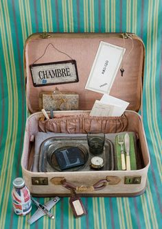 Oh, I like this.  I found a vintage small suitcase recently that would be perfect. (Picnic)