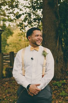 groom in suspenders and bow tie