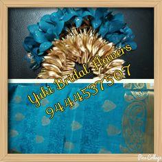 Veni made with fresh blue flowers to match the exquisite kanjeevaram saree