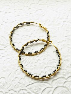 Black Beaded Hoops, Gold Hoops, Black Hoop Earrings, Boho Earrings, Beaded Hoop Earrings, Hoop Earrings with Beads, Large Hoop Earrings Hand wrapped wire with beautiful sparkle black pyrite beading. These I love because you put some jeans on, a simple top, these hoops and hello,