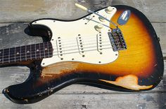 Killer faded finish to this oldie. John Frusciante's 1962 Sunburst Fender Stratocaster – Red Hot Chili Peppers