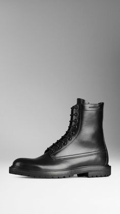 $1,050, Black Leather Boots: Burberry Leather Military Boots. Sold by Burberry. Click for more info: https://lookastic.com/men/shop_items/169077/redirect