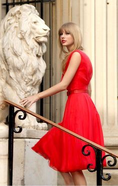 TAYLOR SWIFT...RETRO RED...Taylor's retro silhouette is kept chic with straight sleek hair and sultry makeup.